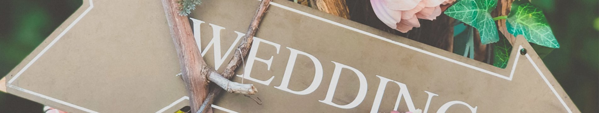 Rustic wedding sign for the entrance with colorful flowers