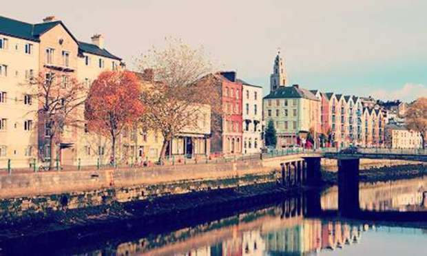Sunrise picture of the colourful buildings along the River Lee. Explore Cork Hen Party ideas below: