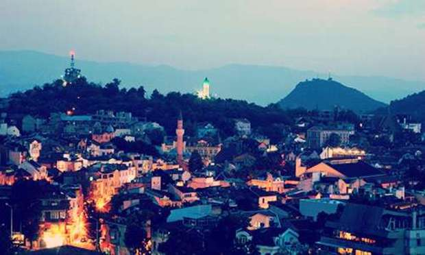 View of the hills where Old Town is lit up at night. Discover Plovdiv Hen Party ideas below: