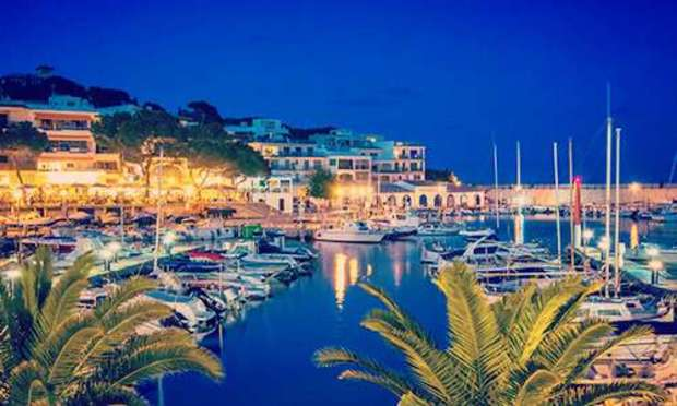 Sailboats and yachts mooring in the shimmering waters of the Puerto Portals marina at night. Discover Puerto Portals Hen Party ideas below: