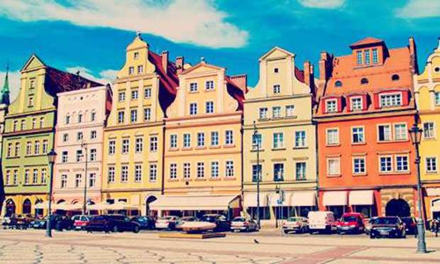 Old Town Square in Wroclaw lined with buildings in various colours. Explore Wroclaw Hen Party ideas below: